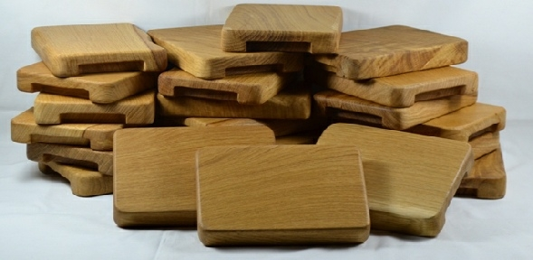 A Group of Small Oak Trivets for presenting Iron Skillets