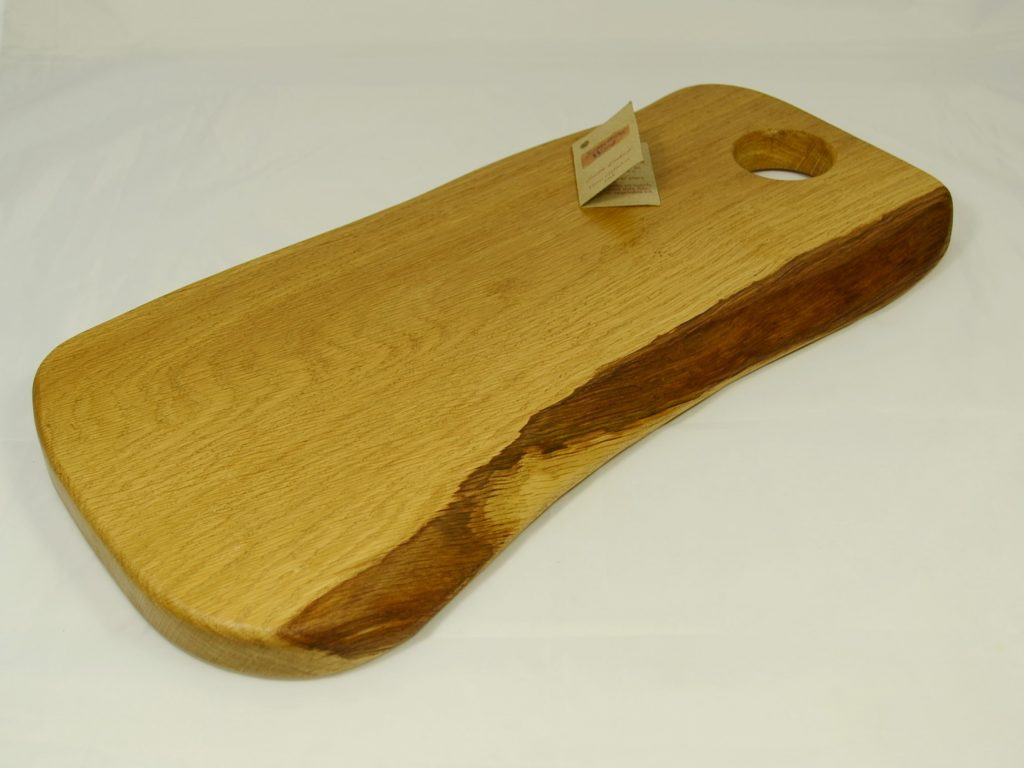 Irregular shaped Oak Board with finger hole